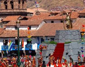 Cusco, Peru - June 24, 2014: IntiRaymi Ceremony showing gold statue in plaza de armas, and performers dressed traditionally, Cusco, Peru