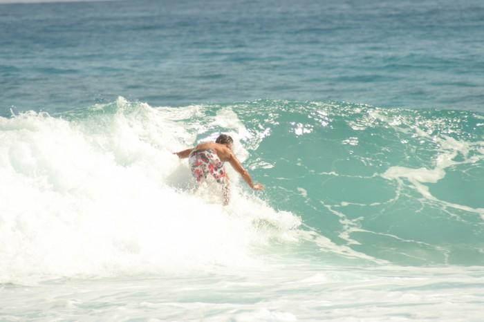 A surfer ride a wave.