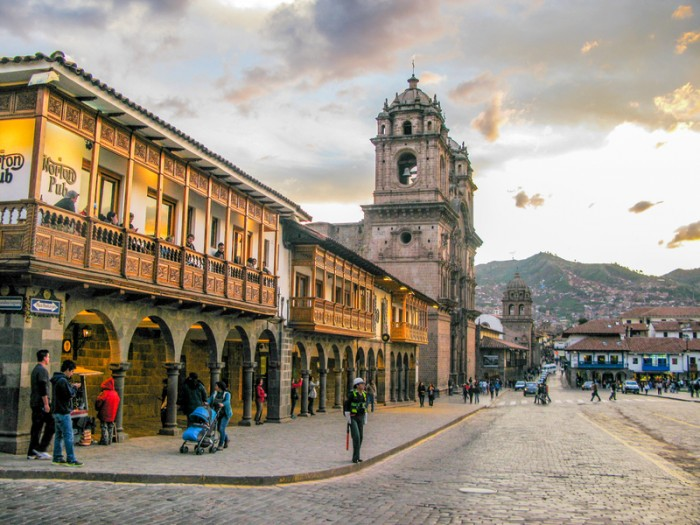 Cuzco,Peru - January 16, 2015: Plaza de armas in sunset with local people. It is a centre point of Cusco city, Cusco, Peru.
