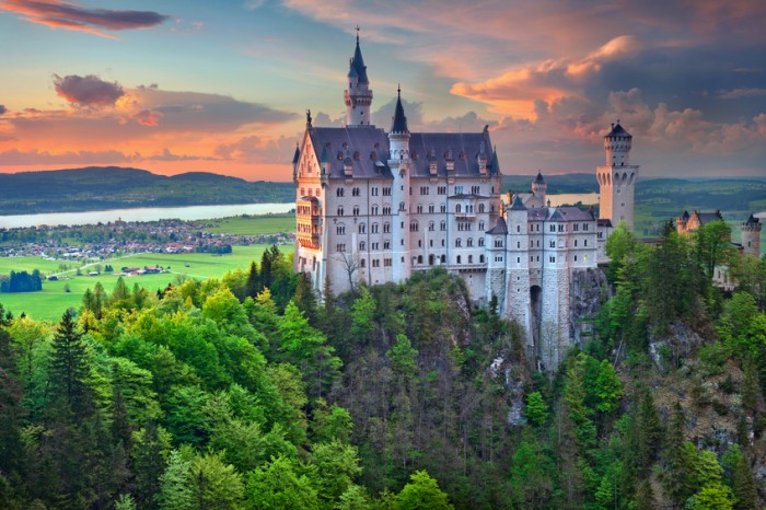 Hohenschwangau, Germany - May 9, 2015: view of Neuschwanstein Castle on may 9th near Hohenschwangau, Germany during spring afternoon surrounded by spring colours.