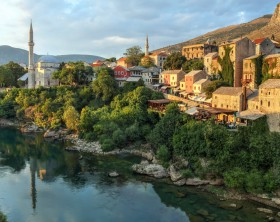 Golden hour over the Neretva river banks of the city of Mostar in Bosnia and Herzegovina seen from the famous bridge.