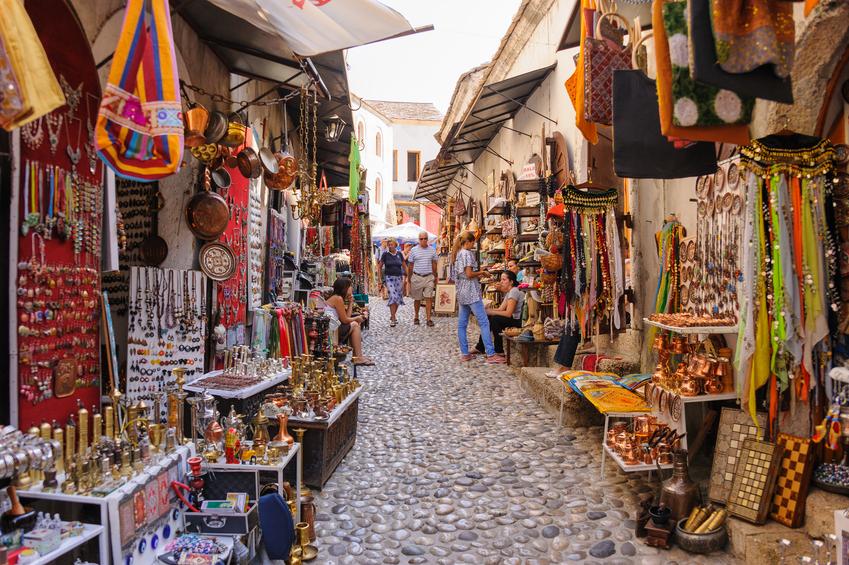 Mostar, Bosnia and Herzegovina - September 1, 2009: Old town east side market shops with people