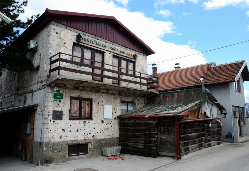 Sarajevo, Bosnia-Hercegovina - March 24, 2015: The house alongside the Sarajevo airport through which the Sarajevo Tunnel connected Bosnia's largest city with other parts of Bosnia during the Siege of Sarajevo. The almost one kilometer long tunnel was constructed in 1993 during the Yugoslav civil war between Bosnians, Croats and Serbs. Note the bullet holes and other marks of warfare on the walls.