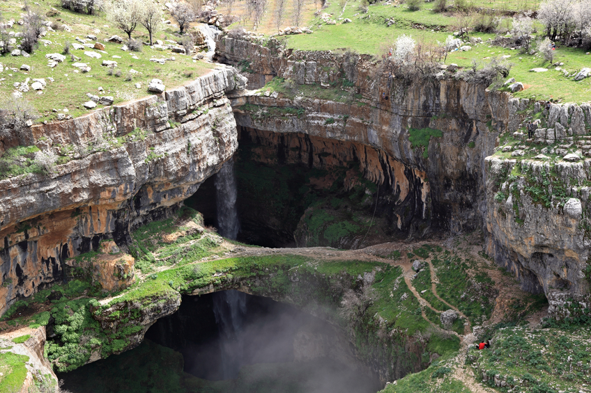 The falls with their natural land bridges are a major tourist attraction and speleological destination.