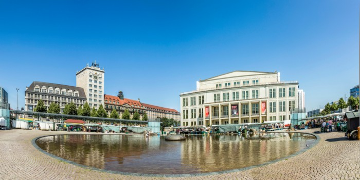 Leipzig, Germany - August 4, 2015: Old Town Hall in Leipzig with marketplace. In about 1165, Leipzig was granted municipal status and market privileges.