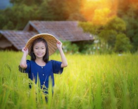 Girl in the terrace rice farm with countryside background