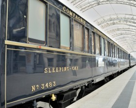 """Dresden, Germany - July 13, 2010: The luxurious """"Orient-Express""""-Train is waiting for passengers in the Central-Station of Dresden and will soon start it's railway-cruise to Prague and Budapest."""