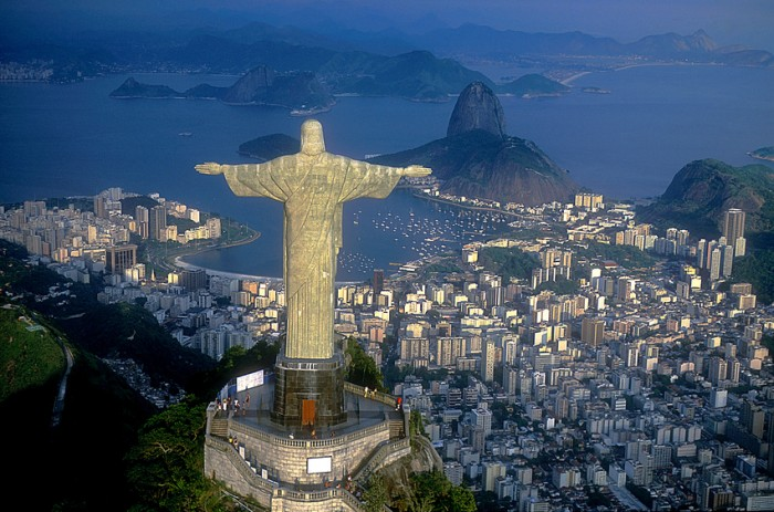 Rio de Janeiro, Brazil - December 15, 2014: Christ, symbol of Rio de Janeiro, standing on top of Corcovado Hill, overlooking Guanabara Bay, Rio de Janeiro, Brazil