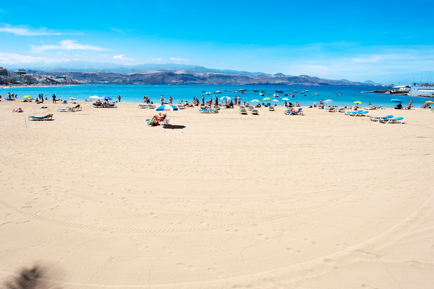 Las Palmas, Gran Canaria, Spain - September 17, 2012: People on the beach at Canteras beach in Gran Canaria on September 17, 2012. Playa Canteras is 3 kilometers long.