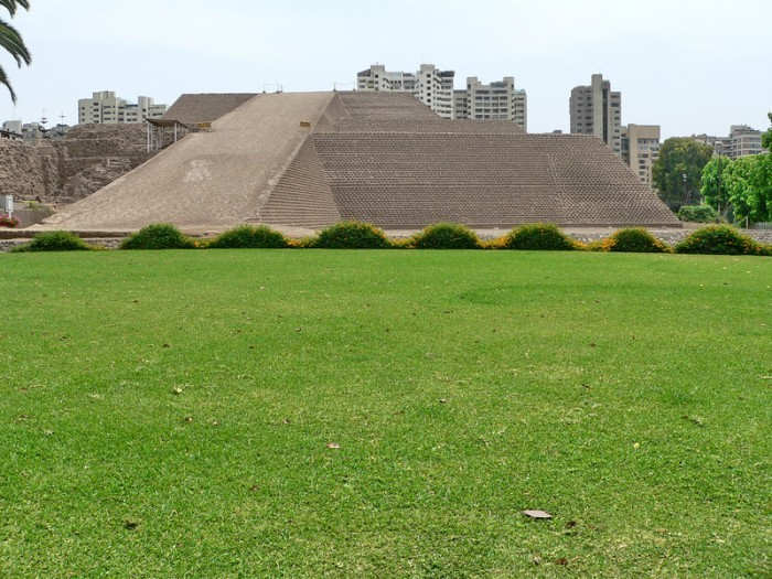 Scenic view of the pyramid called Huaca Huallamarca with c. 2200 years old located in the center of San Isidro District in Lima, Peru. As a Background, there are modern buildings. This huaca is surrounded by buildings and houses.