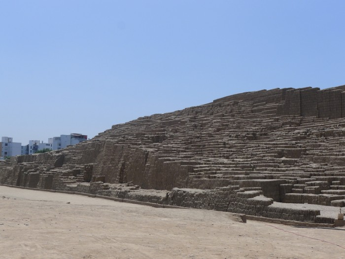 Partial view of a 1700 years old ceremonial archaeological site with anti quake adobe bricks located in Miraflores district of Lima, Peru, and surrounded by modern buildings