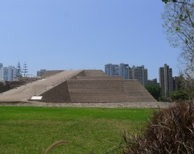 Lima, Peru. November 10, 2015. Side view of the pyramid called Huaca Huallamarca and its gardens. It is circa 2000 years old.  In the district of San Isidro in Lima this important archaeological complex is located in the center of the district surrounded by modern buildings and houses. This photo was taken by a Lumix camera equipped with a Leica lens.