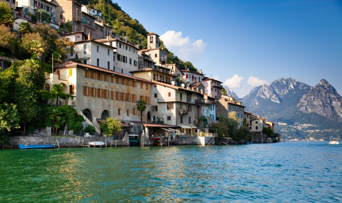 Lugano lake in Switzerland. View on shore with buildings.
