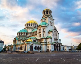 St. Alexander Nevsky Cathedral in the center of Sofia, capital of Bulgaria against the blue morning sky with colorful clouds