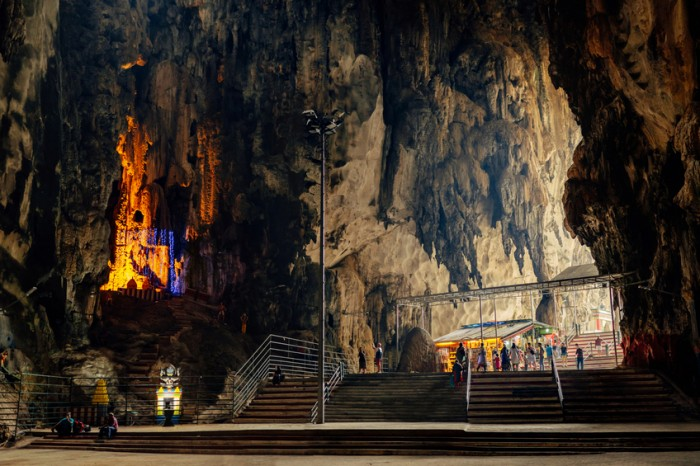 Kuala Lumpur, Malaysia - March 18, 2016: Interior of Batu caves in Kuala Lumpur, Malaysia. The cave is one of the most popular Hindu shrines outside India. Located just north of Kuala Lumpur and has three main caves featuring temples and Hindu shrines. Its main attraction is the large statue of the Hindu God (Lord Murugan) at the entrance and 272 steep climb up to finally caves view.