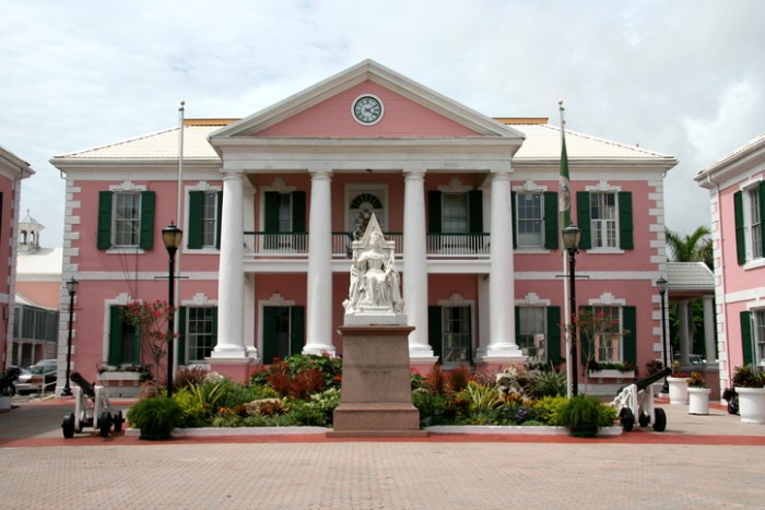 Government House (Parliament) in Rawson Square, Nassau, The Bahamas with statue of Queen Victoria