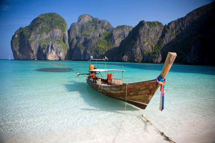 A Long Tail boat sits in the beautiful Maya Bay, Ko Phi Phi Ley, Thailand