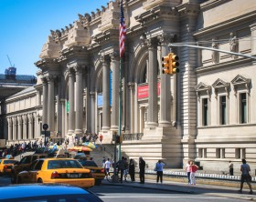 New York, USA - August 12, 2012 : People are walking to the entrance of the Metropolitan Museum of Art in Manhattan located on the eastern edge of Central Park along Manhattan's Museum Mile.