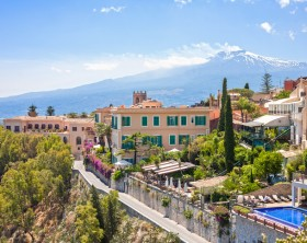 View of Taormina with Etna volcano int the back in Sicily, Italy