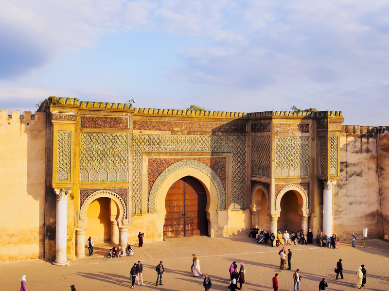 Meknes, Morocco - May 1, 2013: Unidentified people in front of Bab Mansour. The old medina of Meknes is declared UNESCO World Heritage Site.