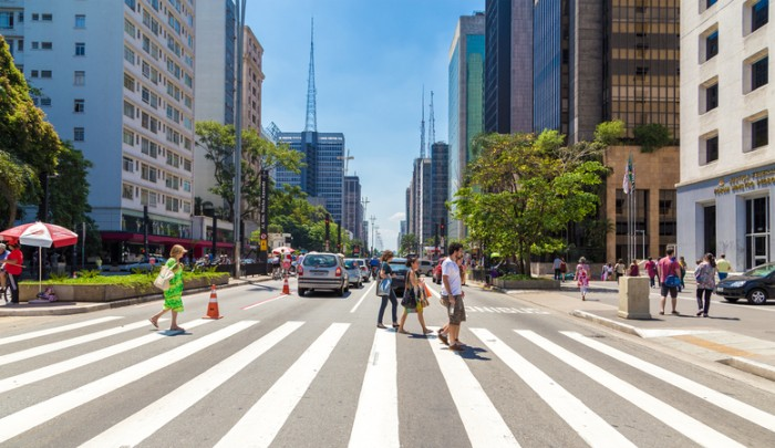 Sao Paulo, Brazil - November 10, 2013: People walking in Paulista Avenue located at the financial heart of the city in Sao Paulo, Brazil.