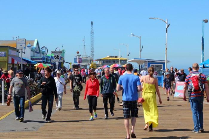 Santa Monica, California - April 6, 2014: People visit the pier in Santa Monica, California. As of 2012 more than 7 million visitors from outside of LA county visited Santa Monica annually.