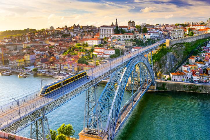 Porto, Portugal cityscape on the Douro River and Dom Luis I Bridge.