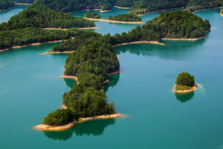 Qiandao Lake (Chinese: 千岛湖, Thousand Island Lake) is a human-made lake located in Chun'an County, Zhejiang Province, China, near Hangzhou City. 1,078 large islands dot the lake and a few thousand smaller ones are scattered across it.