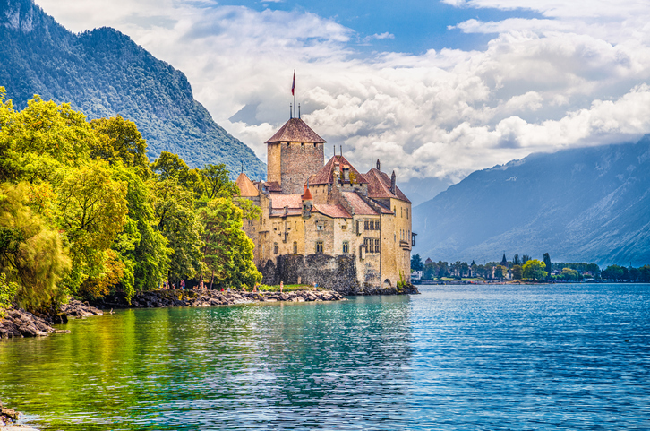 Montreaux, Switzerland - August 10, 2015: Beautiful view of famous Chateau de Chillon at Lake Geneva, one of Switzerland's major tourist attractions and one of the most visited castles in Europe, Canton of Vaud, Switzerland.