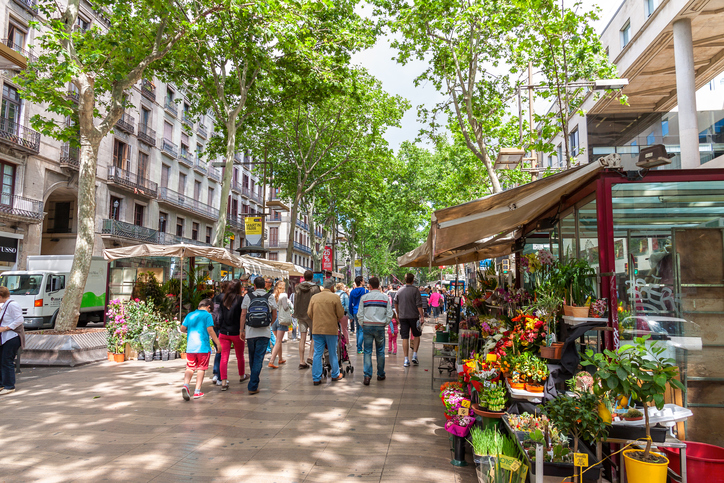 Barcelona, Spain - May 2, 2014: Las Ramblas in Barcelona.Thousands of people walk daily by this popular pedestrian street.