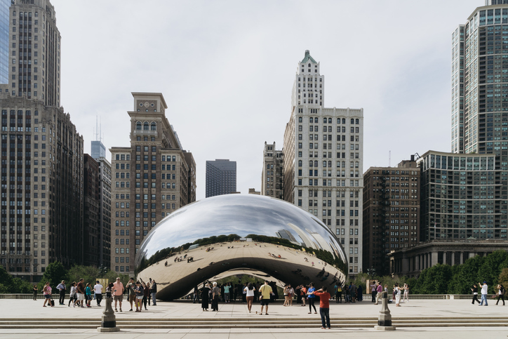 Millennium Park Chicago USA - September 24 2015: Cloud Gate also known as the Bean is one of the parks major attractions.