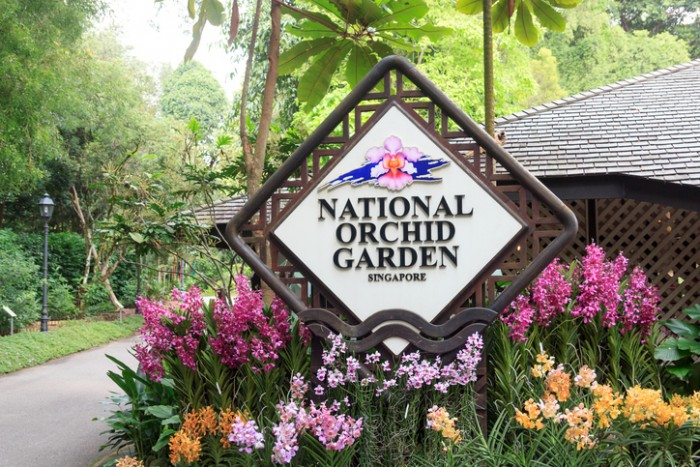 Singapore, Singapore - May 22, 2015: National Orchid Garden sign. The National Orchid Garden is located within the Singapore Botanic Gardens. It is honored as a UNESCO World Heritage Site.
