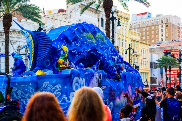 New Orleans USAFeb 1 2016: Mardi Gras parades through the streets of New Orleans. People arecelebrating and welcoming locals and visitors.Thisis the biggest annual celebration of the city.