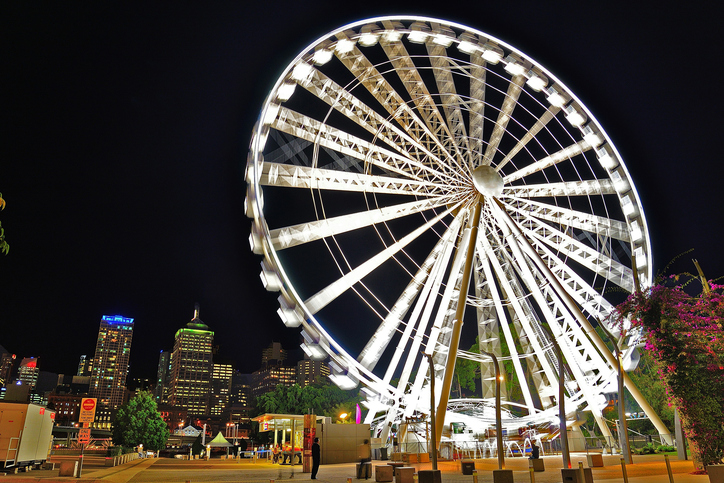 Beautiful Brisbane Wheel illuminated in white at night creates an amassing picture.