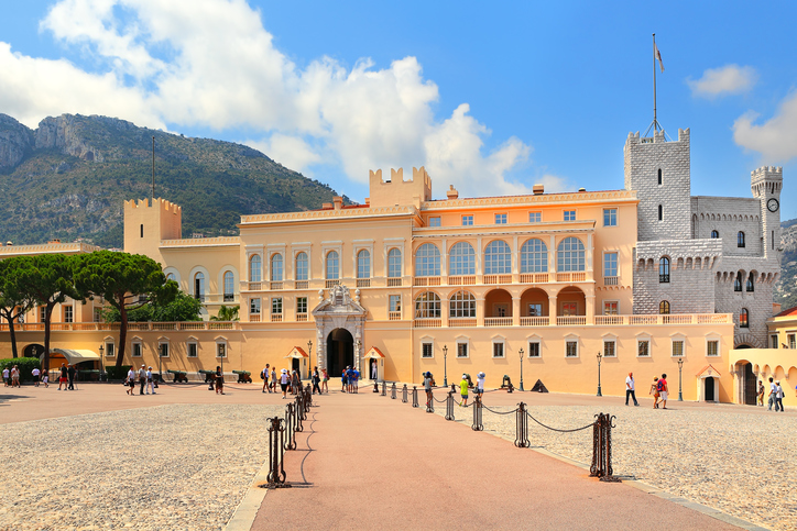 Monaco-Ville, Monaco - July 26, 2013: Tourists in front of Exterior Royal Palace - official residence of Prince of Monaco. It is one of the major tourist attraction and remains fully working palace  in Monaco on July 27, 2013.