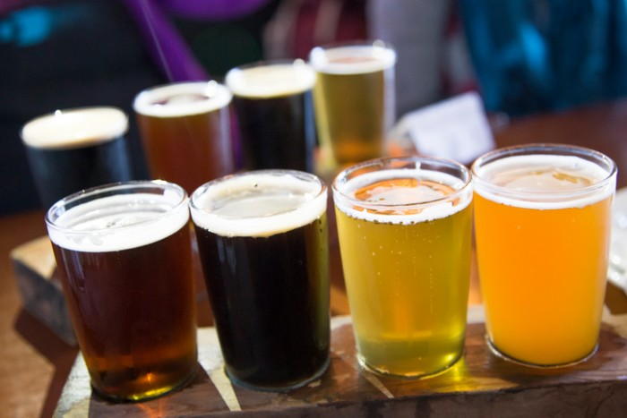 Two flights of visually cold craft beer on a tray
