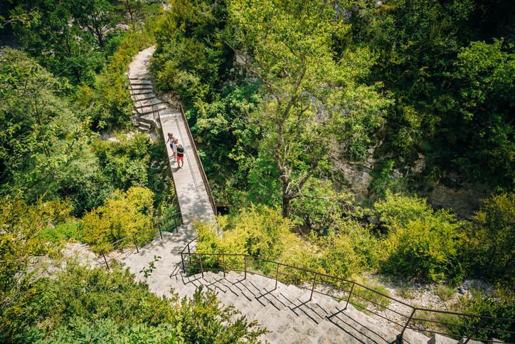 Verdon, France - June 29, 2015: Tourists descend the steps to the mountain river Le Verdon in the Verdon Gorge in south-eastern France. Provence-Alpes-Cote d'Azur.