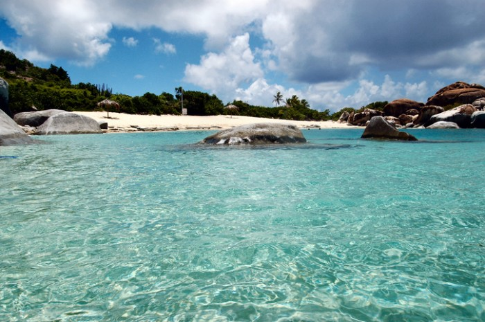 Boulders, turquoise waters and sandy beach