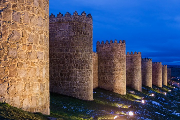 """?vila's 11th century city walls are the most important and best preserved of the Spanish medieval walls, circling the medieval city. The walls have a perimeter of 2516 meters, and are 12 meters high and 3 meters thick, with 88 towers and 9 gates. The Walls have throughout history been an active and determining factor in the way the urban development of ?vila was configured and in the distribution of the urban space amongst the various social groups which lived here (craftsmen, noblemen, clergy, Jews, """"mud?jares"""" (Muslims permitted to live under Christian rule), vegetable gardeners, and so on). These walls represented an unconquerable bastion against the enemy, and have remained intact throughout the centuries."""
