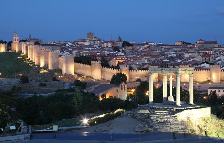 Medieval city of Avila illuminated at dusk. Castile and Leon, Spain