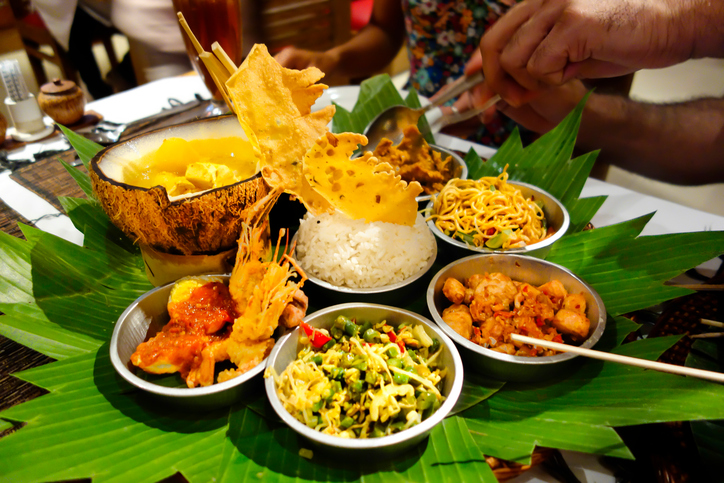 A table laid with a feast of Indonesian food dishes