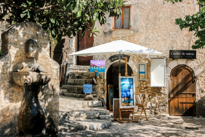 Eze Village, Alpes-Maritimes, France - October 02, 2016: paintings in an art gallery under sunshine in Eze Village, France.