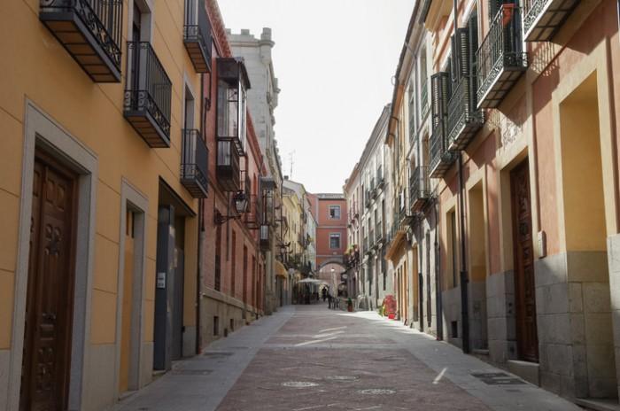 Avila, Spain - March 5, 2011: View narrow old street near market  square  of medieval Avila town.  Castile and Leon, Spain