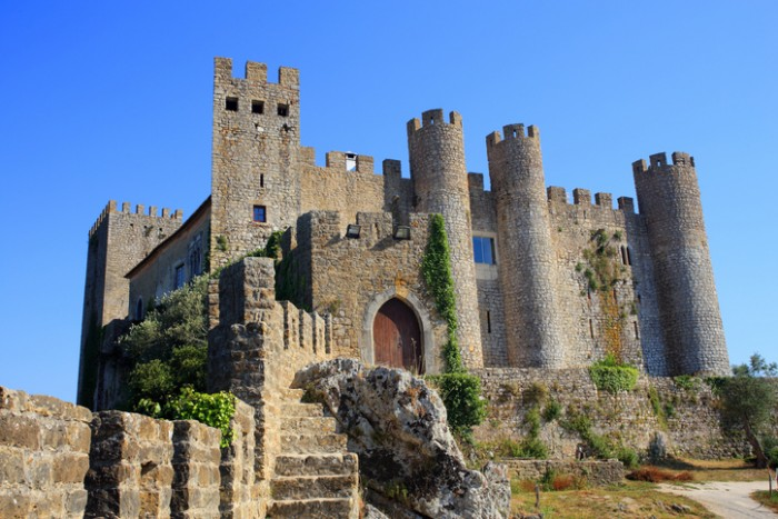 Obidos, Portugal - June 20, 2015: The castle and picturesque medieval town of Obidos attract both international and local tourists. It is one of Portugal's most visited landmarks.