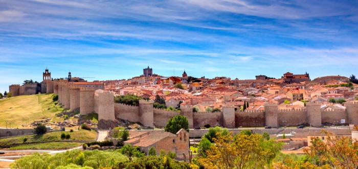 Avila Ancient Medieval City Walls Castle Swallows Castile Spain.  Avila is described as the most 16th century town in Spain.  Walls created in 1088 after Christians conquer and take the city from the Moors. Public town, not a private castle.