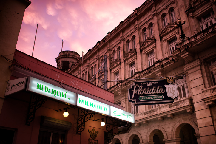 Havana, Cuba - June 3, 2015: The Floridita bar, Hemingway's favourite bar in Havana, Cuba, late in the evening. Lights are on to let customers know they've opened.