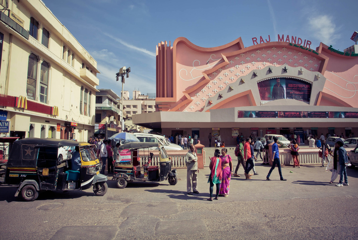 Jaipur, India - February 22, 2015: People going to a famous movie theater Raj Mandir, opened in 1976 in Pink City on February 22, 2015. Jaipur, with population 6,664000 people, is a capital of Rajasthan