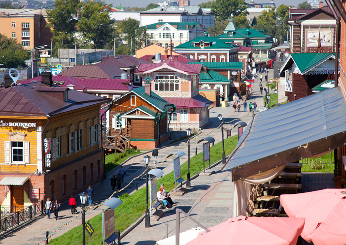 Irkutsk, Russia - September 17, 2016: Street with typical Russian log cabins located in the Irkutsk Sloboda (130 Quarter).