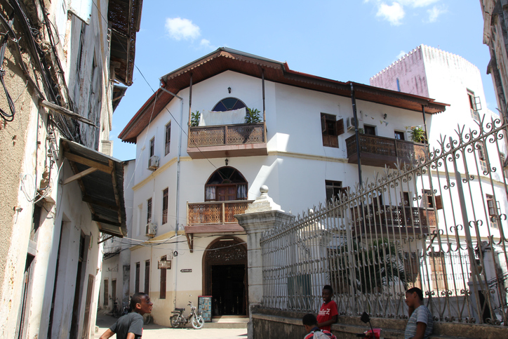 """Alleys dominate the streets in Stone Town, which is also named Mji Mkongwe (Swahili for """"old town""""). People walk in the streets of Stone Town, which is the historic part of Zanzibar City, the main city of Zanzibar island. Zanzibar is a semi-autonomous part of Tanzania in East Africa."""