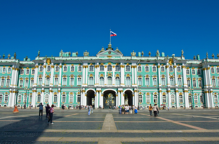 St. Petersburg, Russia - July 03, 2012: Winter palace of Russian kings, now State Hermitage art museum on Palace square, unidentified people on the square.